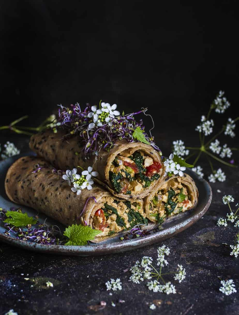 Spelt crepes with tofu spinach and cherry tomatoes