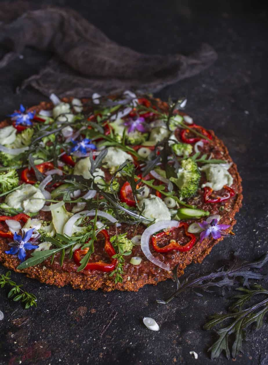 Raw pizza crust and toppings